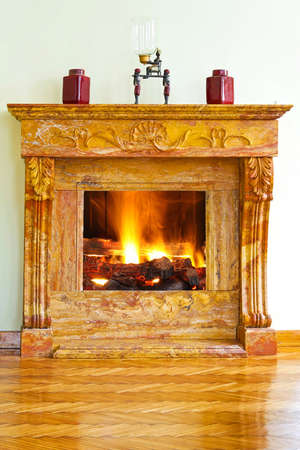 Interior with luxurious yellow marble fire place photo