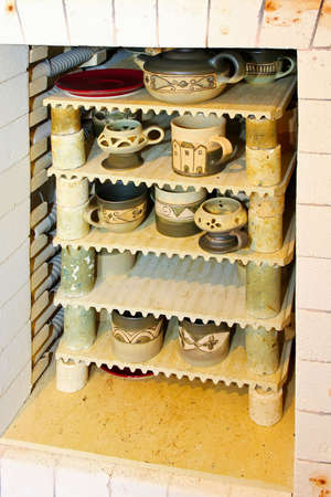 kiln: Ceramic production kiln oven with cups and mugs