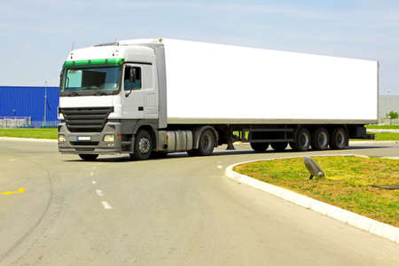 Side view of long white semi lorry photo