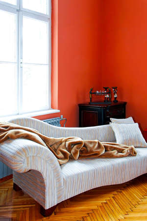 divan sofa: Orange living room corner with retro sofa