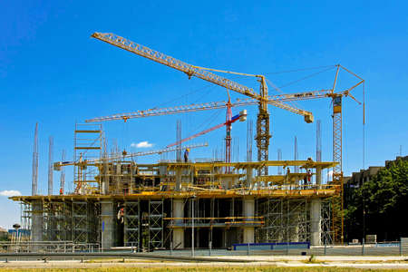 constructing: Big building construction site with several cranes Stock Photo