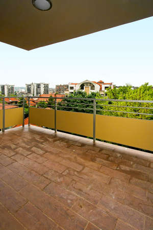 Big square balcony terrace with yellow fence photo