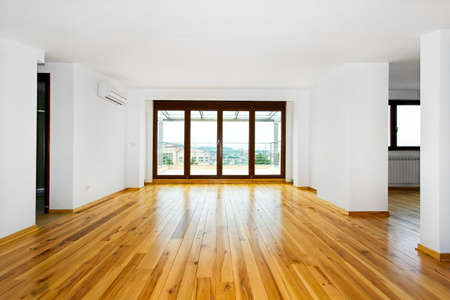 wood flooring: New empty living room with four glass doors