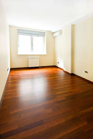 hardwood flooring: Interior of new empty room with brown parquet