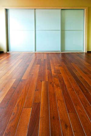slide glass: Big closet with glass doors in empty room