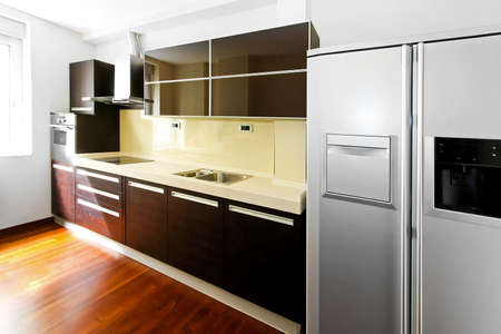 Interior of contemporary kitchen with dark counter photo