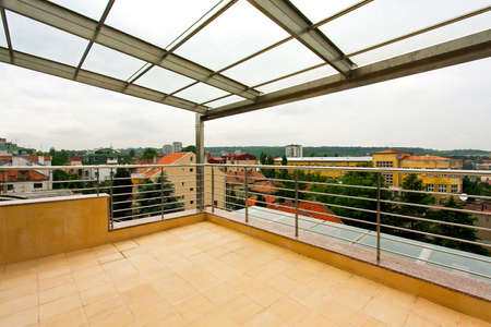 Terrace with glass roof at penthouse appartment photo