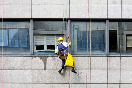 Windows cleaner at danger and risky work photo
