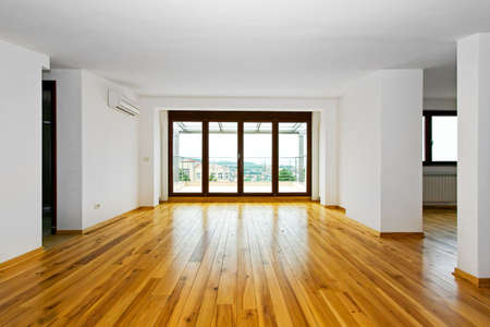 apartment: New empty living room with four glass doors