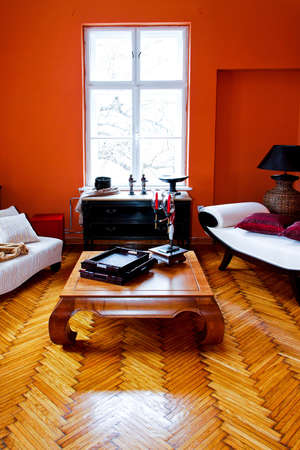 Orange living room with vintage style furniture photo