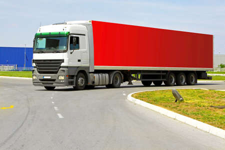 Side view of long red semi lorry  photo