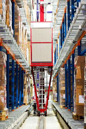 storage box: Automatic box transportation robot in big warehouse  Stock Photo
