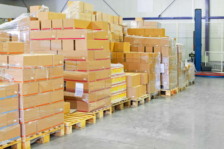 goods: Big pile of box package in warehouse  Stock Photo