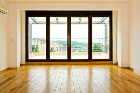 hardwood: Four glass doors in empty living room