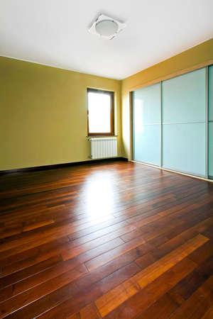 Big closet with glass doors in empty room photo