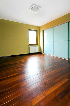 Big closet with glass doors in empty room photo