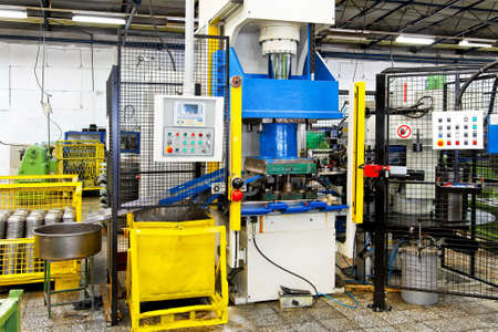 automated: Hydraulic press heavy machine and factory interior Stock Photo
