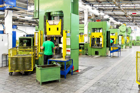 Manufacturing plant: Metal production heavy machines and factory interior