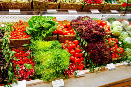 Big shelf in supermarket with fresh vegetables photo