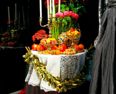Festive Christmas table with lot of fruits photo