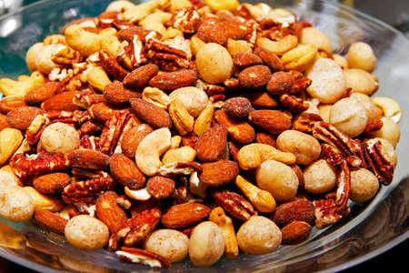 Big bunch of mixed cashew and macadamia nuts photo