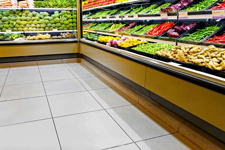 Long rack in supermarket with fresh vegetables Stock Photo - 5904545