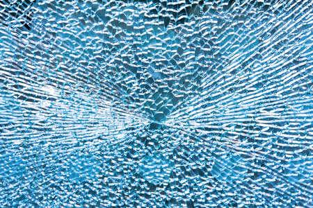 Close up shot of broken blue glass photo