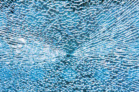 cracked glass: Close up shot of broken blue glass Stock Photo