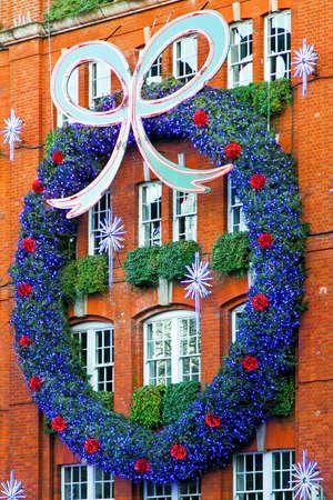 Angle shot of big Christmas wreath at building facade Stock Photo - 5952710