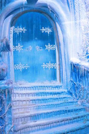 ice sculpture: Blue door and frozen stairway at winter night