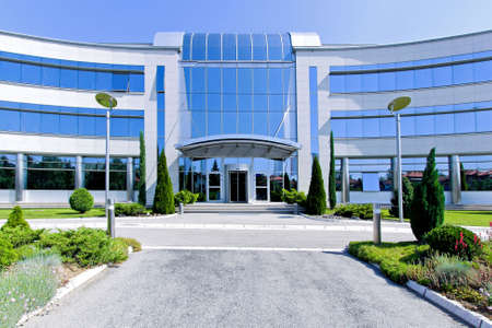 commercial architecture: Front view of blue glass office building