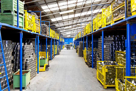 steel factory: Interior of big warehouse in metal factory Stock Photo