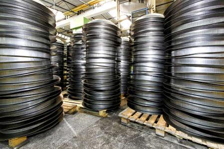 blanks: Piles of pan blanks in factory warehouse