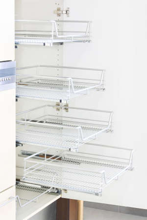White kitchen cabinet with several wire shelves Stock Photo - 6017169
