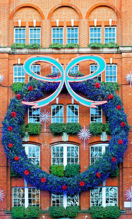 Big Christmas wreath decor at building facade Stock Photo - 6044855