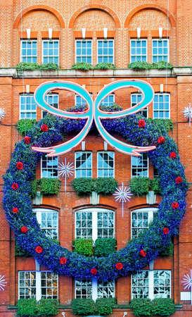 Big Christmas wreath decor at building facade Stock Photo - 6044855