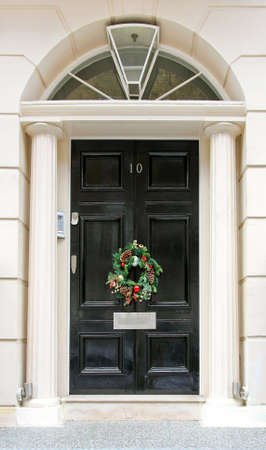 Luxurious front door with conifer Christmas wreath photo