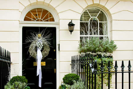 front of house: Luxurious front door with conifer Christmas wreath Stock Photo