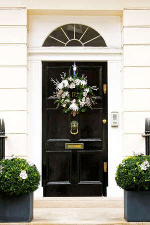 Christmas wreath with pine cones at door Stock Photo - 6044839