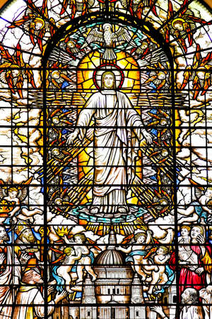 Jesus Christ at stained glass window in church photo
