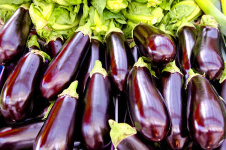 eggplants: Bunch of organic eggplants sold on a market stall Stock Photo