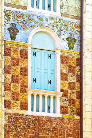 craftsmanship: Beautiful craftsmanship on old residential building facade