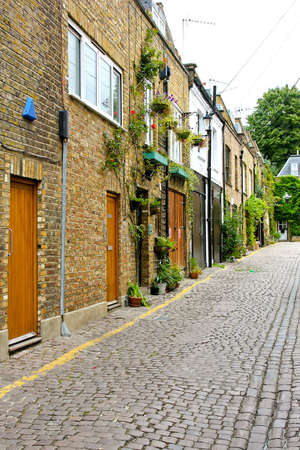 Old houses in small cobbled street in London