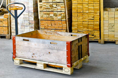 Hand powered pallet jack with wooden box Stock Photo - 8474870