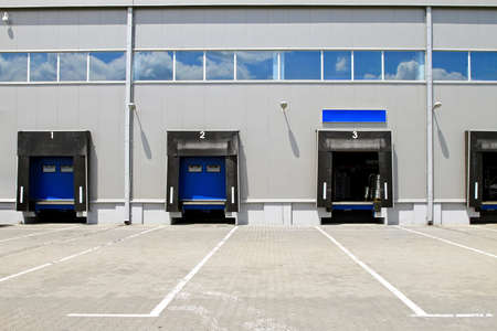 Three cargo door ramp at warehouse building