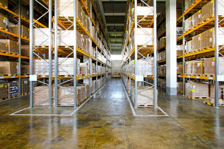 Boxes in modern logistic distribution warehouse interior Stock Photo - 9095338