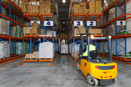 Forklift driver handling goods in distribution storehouse Reklamní fotografie