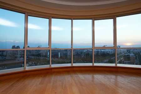 Big glass wall in oval living room with view Stock Photo - 11813734