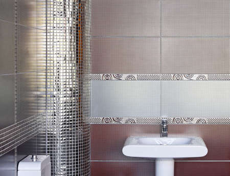 Contemporary toilet interior with silver wall tiles Stock Photo - 12880357