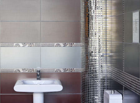 Contemporary toilet interior with silver wall tiles photo